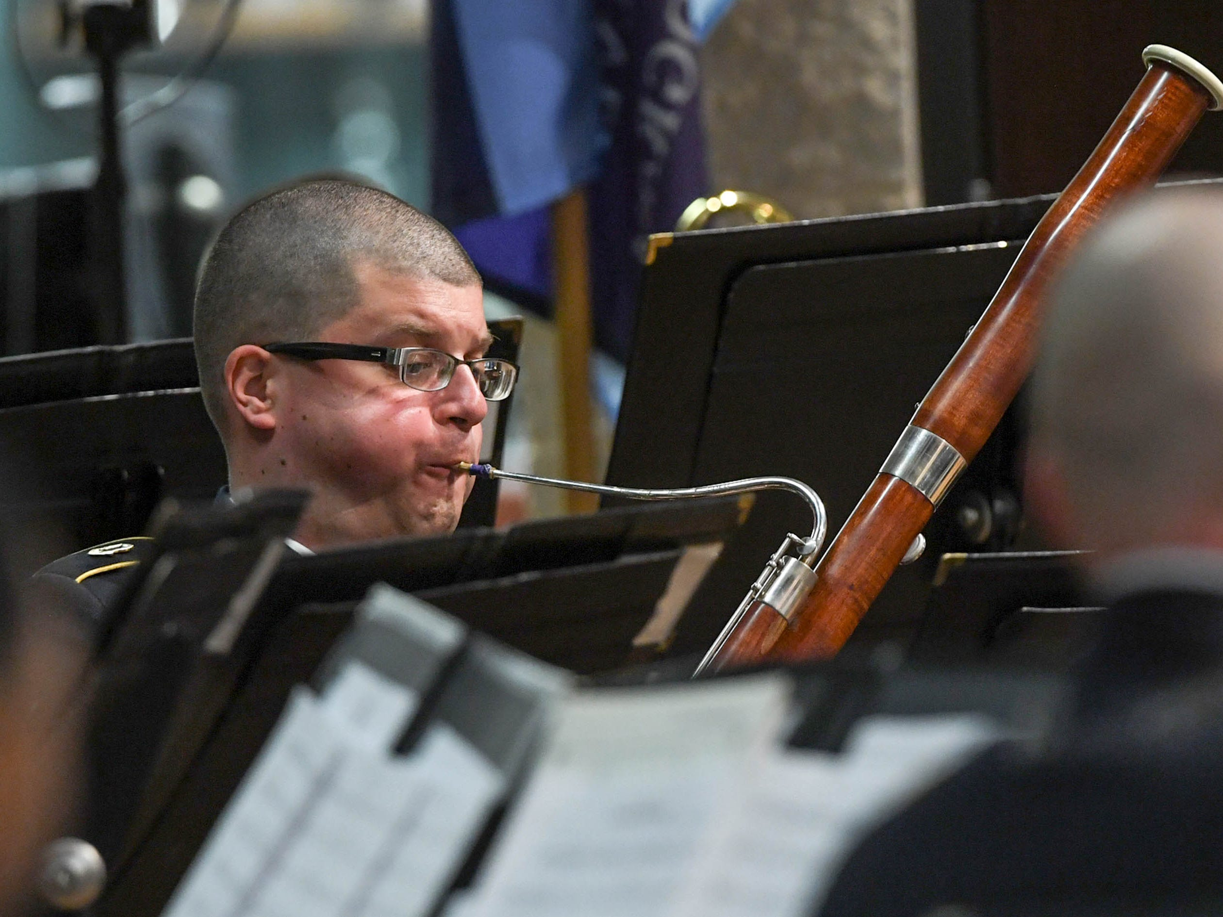 SGT Martin Van Klompenberg of the 282d U.S. Army Band plays bassoon during a free concert at T.L. Hanna High School in Anderson Thursday, March 7.