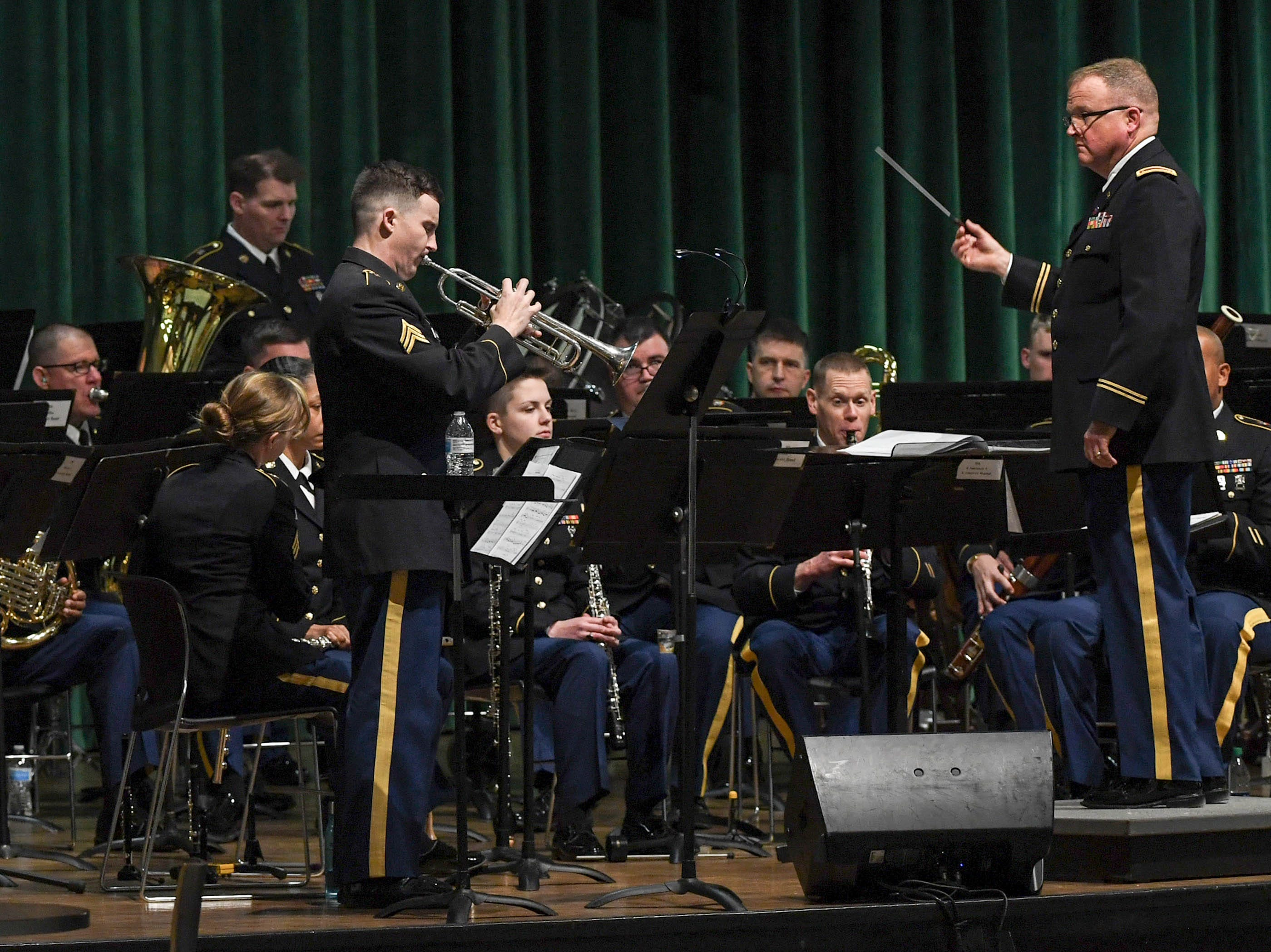 "Commander George T. Bauer, right, leads SGT Billy Gibson of the 282d U.S. Army Band performing a solo for ""Fantasie Brillante"" by Jean-Baptist Arban during a free concert at T.L. Hanna High School in Anderson Thursday, March 7. Bauer, a Clemson native who graduated from D.W. Daniel High in 1987, leads the band March 8 at the school in Central."