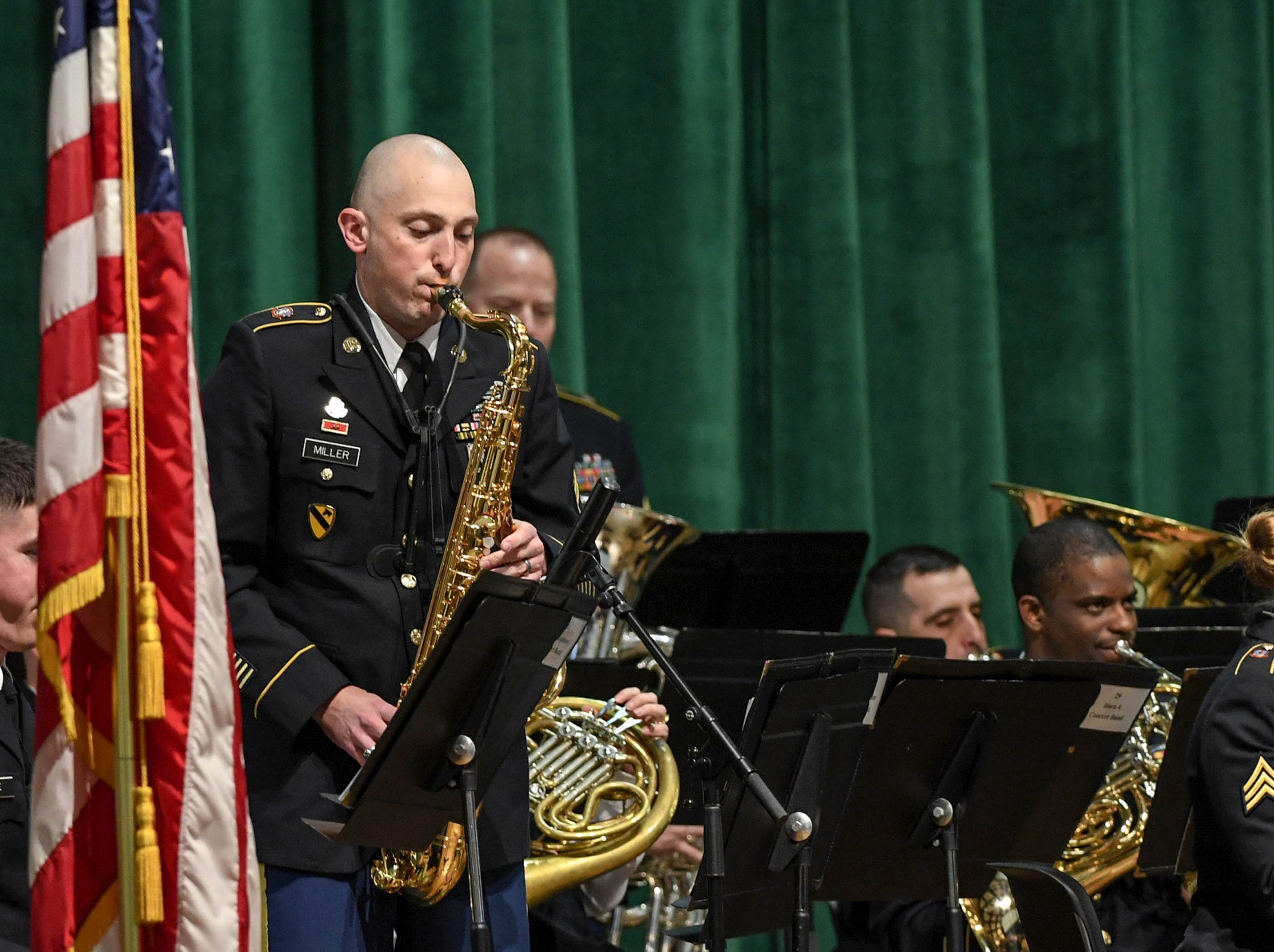 SGT William Gibson plays saxophone solo with the 282d U.S. Army Band during a free concert at T.L. Hanna High School in Anderson Thursday, March 7.
