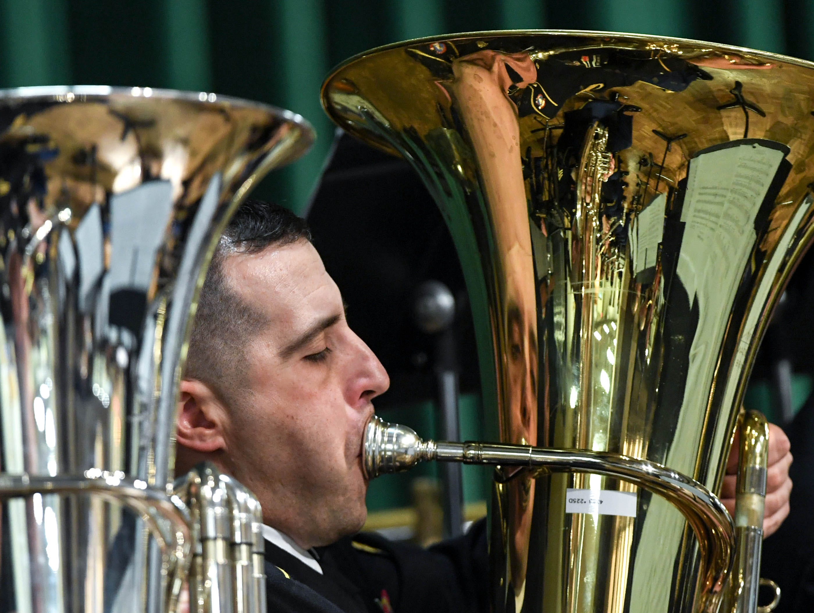 SGT Justin Stowe of Hartwell, Georgia, plays tuba with the 282d U.S. Army Band during a free concert at T.L. Hanna High School in Anderson Thursday, March 7.