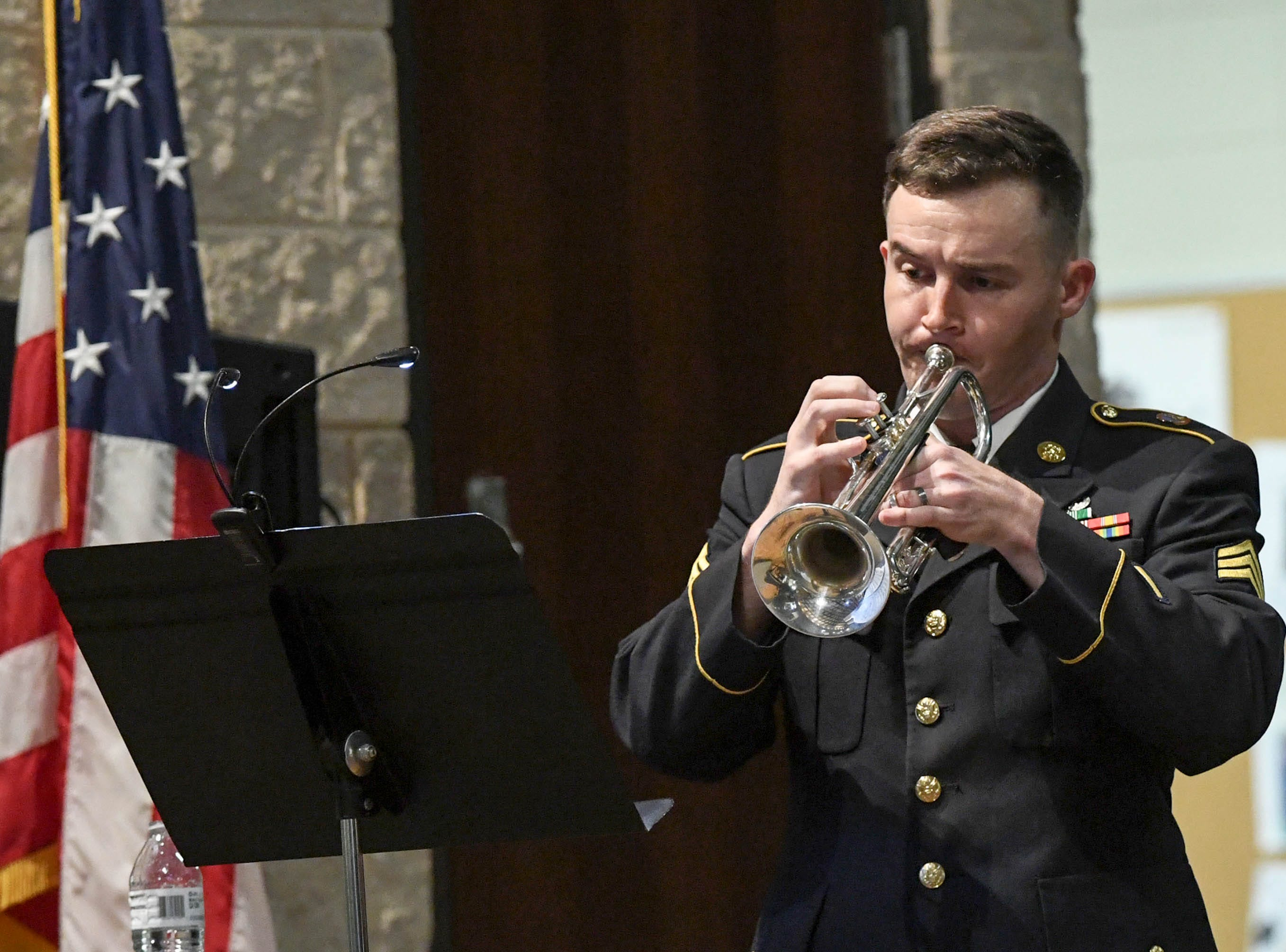 "SGT Billy Gibson of the 282d U.S. Army Band performs a solo for ""Fantasie Brillante"" by Jean-Baptist Arban during a free concert at T.L. Hanna High School in Anderson Thursday, March 7."