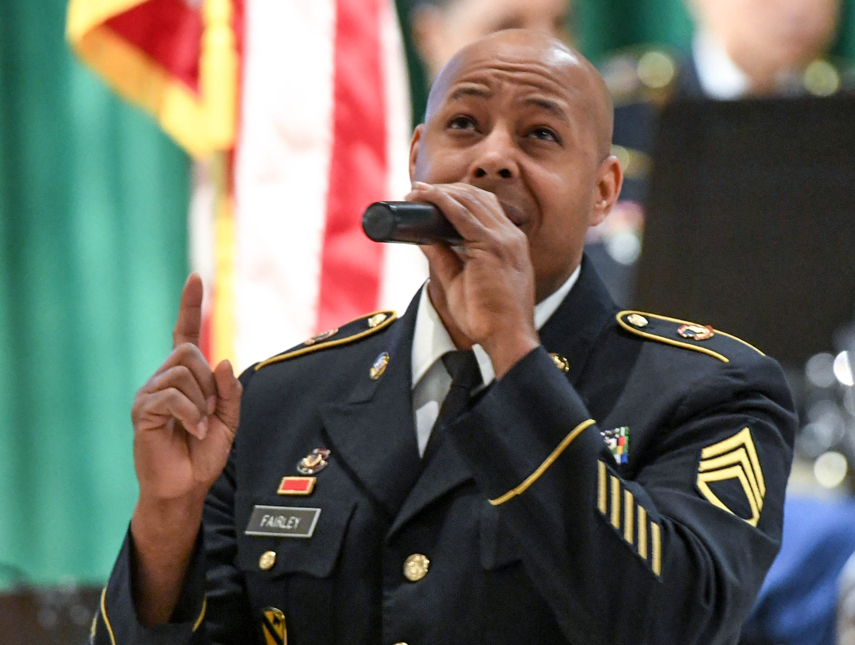 "SSG Chris Fairley sings ""God Bless the USA"" by Lee Greenwood, a solo with the 282d U.S. Army Band during a free concert at T.L. Hanna High School in Anderson Thursday, March 7."
