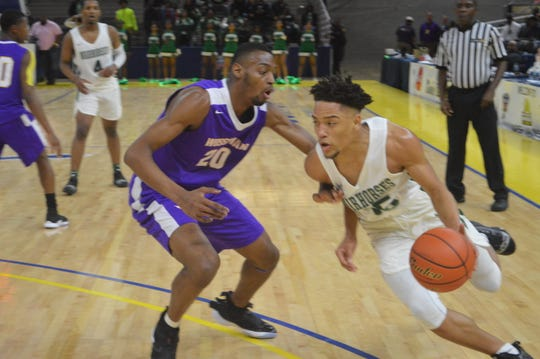 Peabody's Kevin Scott (35, right) drives for two points against Wossman's LaJarrion Spinks Thursday during the Class 3A semifinals.