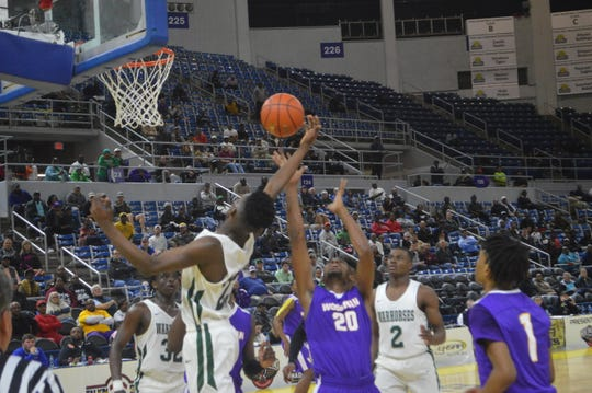 Wossman's LaJarrion Spinks (20) and Peabody's Darius Smith battle for a rebound Thursday during the Class 3A semifinals.