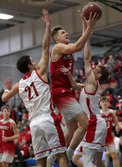 Neenah High School's #21 Logan Marrow and #2 Jake Hablewitz against Kimberly High School's #5 Reed Miller during their WIAA Division 1 boys basketball sectional semi-final on Thursday, March 7, 2019, at Oshkosh West High School in Oshkosh, Wis. Neenah defeated Kimberly 57 to 56.