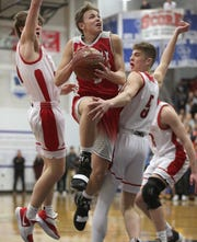 Neenah's Bryce Henderson and Max Klesmit (5) defend against Kimberly's Jake Buchanan during a WIAA Division 1 boys basketball sectional semifinal last March.