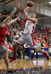 Neenah High School's #21 Logan Morrow against Kimberly High School's #13 Braeden Thies during their WIAA Division 1 boys basketball sectional semi-final on Thursday, March 7, 2019, at Oshkosh West High School in Oshkosh, Wis. Neenah defeated Kimberly 57 to 56.