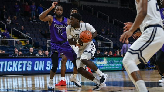 Monmouth's Ray Salnave drives to the basket for two of his game-high 20 points in a 76-72 victory over Niagara in the opening round of the MAAC Tournament in Albany, N.Y. on March 7, 2019.