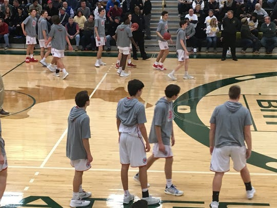The Wall boys basketball team warms up before the NJSIAA Group III State Semifinal on March 7, 2019