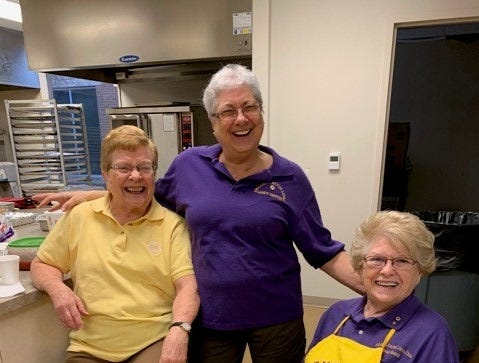 Betty Landry, Sandy Griffin and Dean Baird volunteer at the Abilene Cactus Lions Club's spaghetti dinner fundraiser.