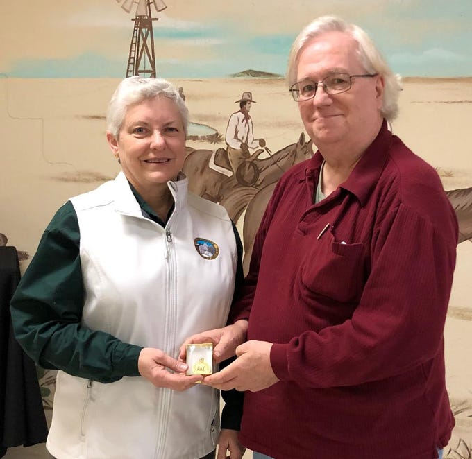 Terry Steele (right) presents the American Kennel Club Outstanding Sportsmanship Award to Lisa Peterson (left) at the Abilene Kennel Club's Sportsmanship Dinner on Feb. 18. The award recognizes members of local clubs who deserve special recognition. Peterson has been a member of the club for 35 years.