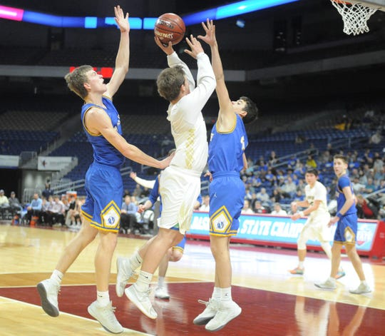 Jayton senior Kaden Awe shoots in between two Nazareth defenders in a Class 1A semifinal Thursday, March 7, 2019, at the Alamodome.