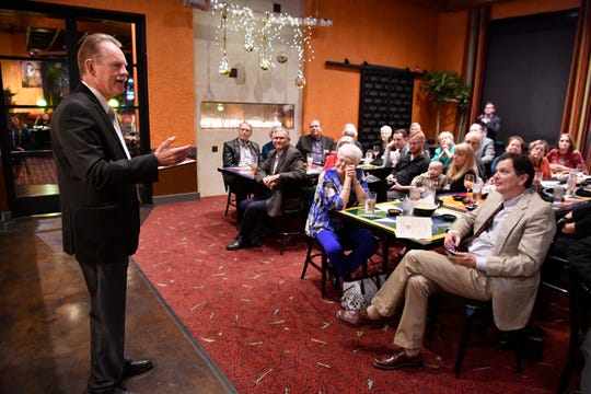 Larry Sanders addresses the audience after receiving the Taylor County Historical Commission's Maxine Perini Award at Miguel's Mex-Tex.