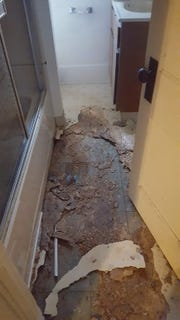 To say the least, the bathroom was rough, with leaks that had eroded the sub-flooring. Jason McGill totally gutted the bathroom, removing the tub, sink and toilet and installing new tile and fixtures.