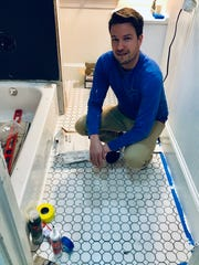 Jason McGill has had plenty of help on his home renovation project, including assistance on bathroom tiling. The bathroom needed a total redo.