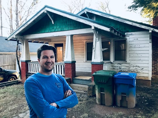 Jason McGill, a high school English teacher and soccer coach, has spent the past three months renovating an old home in West Asheville. He'll hit the exterior next.