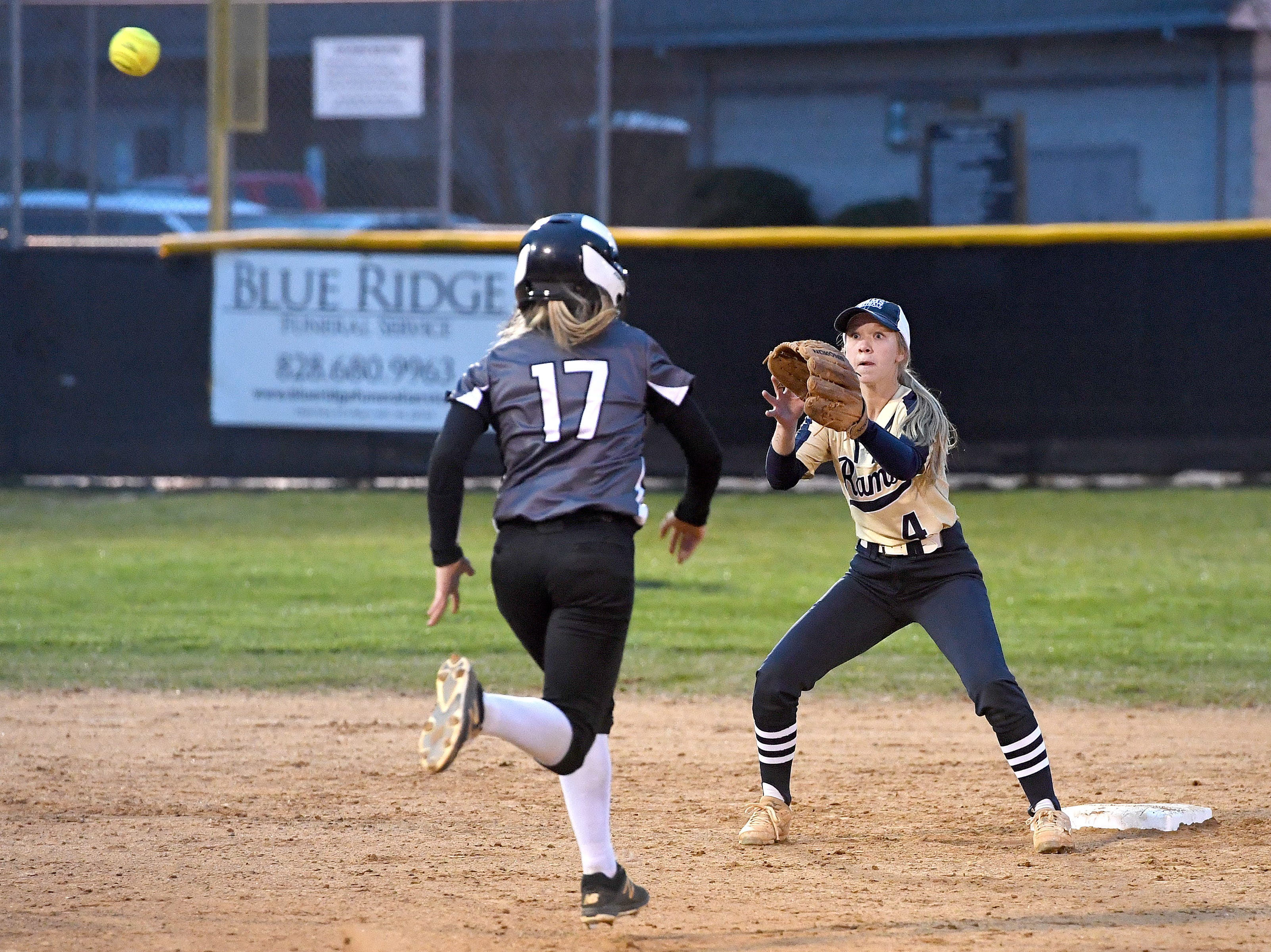 North Buncombe's Riley McCurry runs for second base as Roberson's Hayley Morrow makes the play during their game at North Buncombe High School on March 7, 2019. North Buncombe defeated Roberson 3-1.