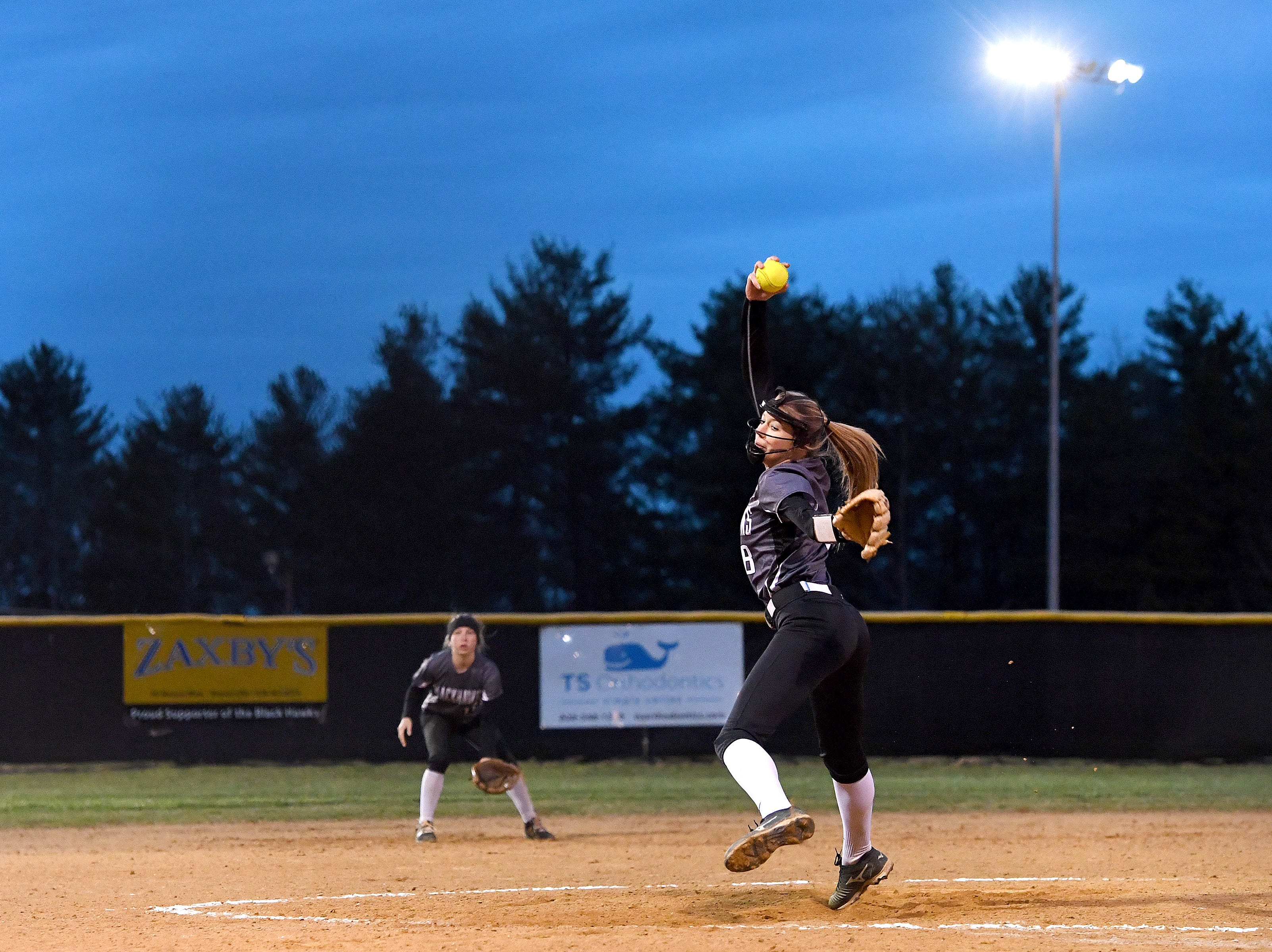 North Buncombe's 8 delivers a pitch against Roberson during their game at North Buncombe High School on March 7, 2019. North Buncombe defeated Roberson 3-1.