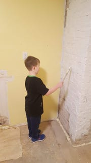 Jason McGill has enrolled the help of numerous friends and family members on his home renovation, including his 7-year-old son, Graeme, here helping paint a wall in the kitchen.