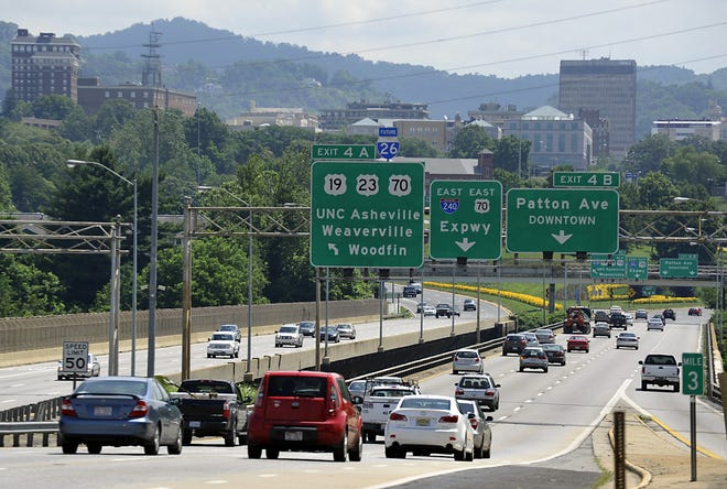 I-26W, I-240E, and Patton Ave. traffic cross the Jeff Bowen bridge over the French Broad River looking east toward downtown in this file photo. An NCDOT project to install new lighting on the bridges and nearby interstate should be completed in November.