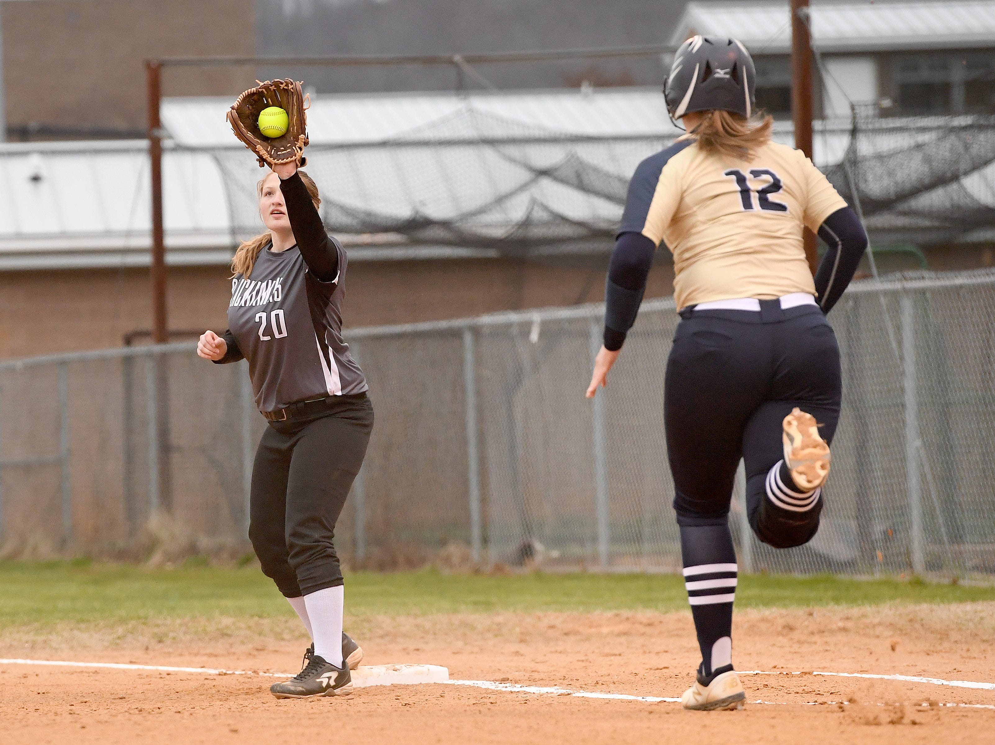 North Buncombe's Cassie Plemmons makes a play at first ahead of Roberson runner, Kristen Belknap, during their game at North Buncombe High School on March 7, 2019. North Buncombe defeated Roberson 3-1.