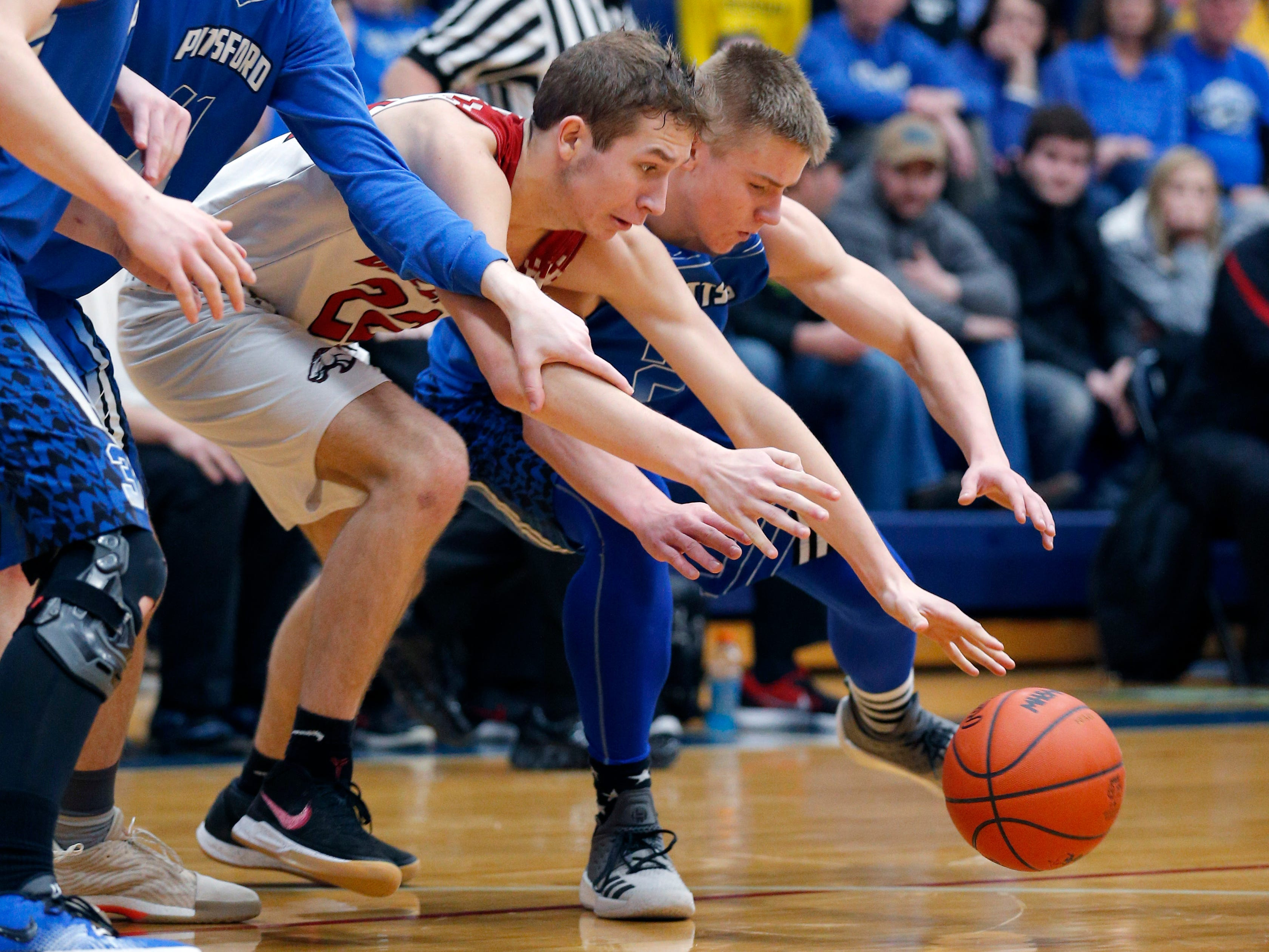Pittsford's Zachery Gigowski, right, and Bellevue's Carter Wing vie for the ball in their regional final, Thursday, March 7, 2019, in Fowler, Mich. Bellevue won 42-28.