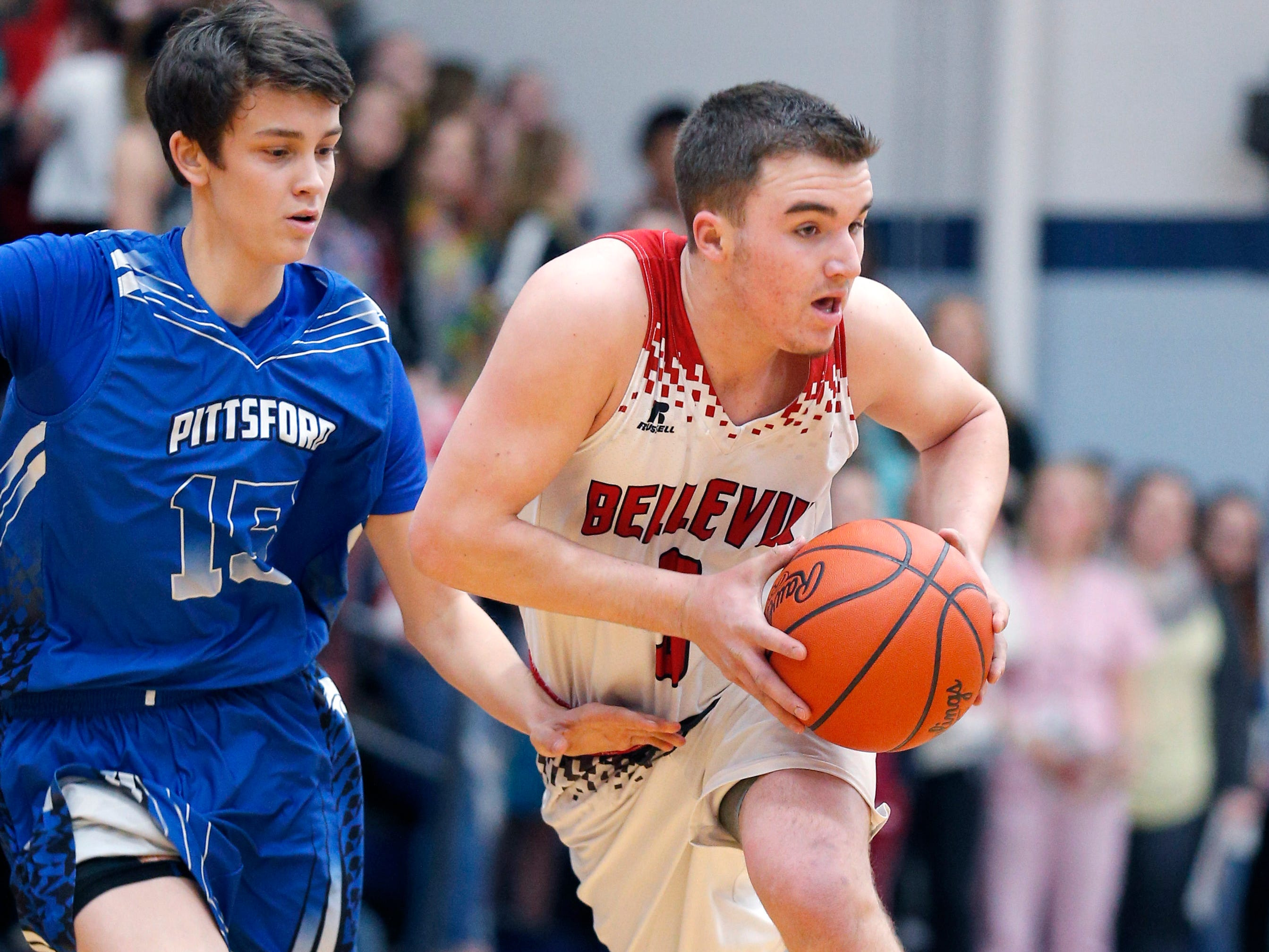 Bellevue's Gino Costello, right, drives against pressure from Pittsford's Zachary Bowers in their regional final, Thursday, March 7, 2019, in Fowler, Mich. Bellevue won 42-28.