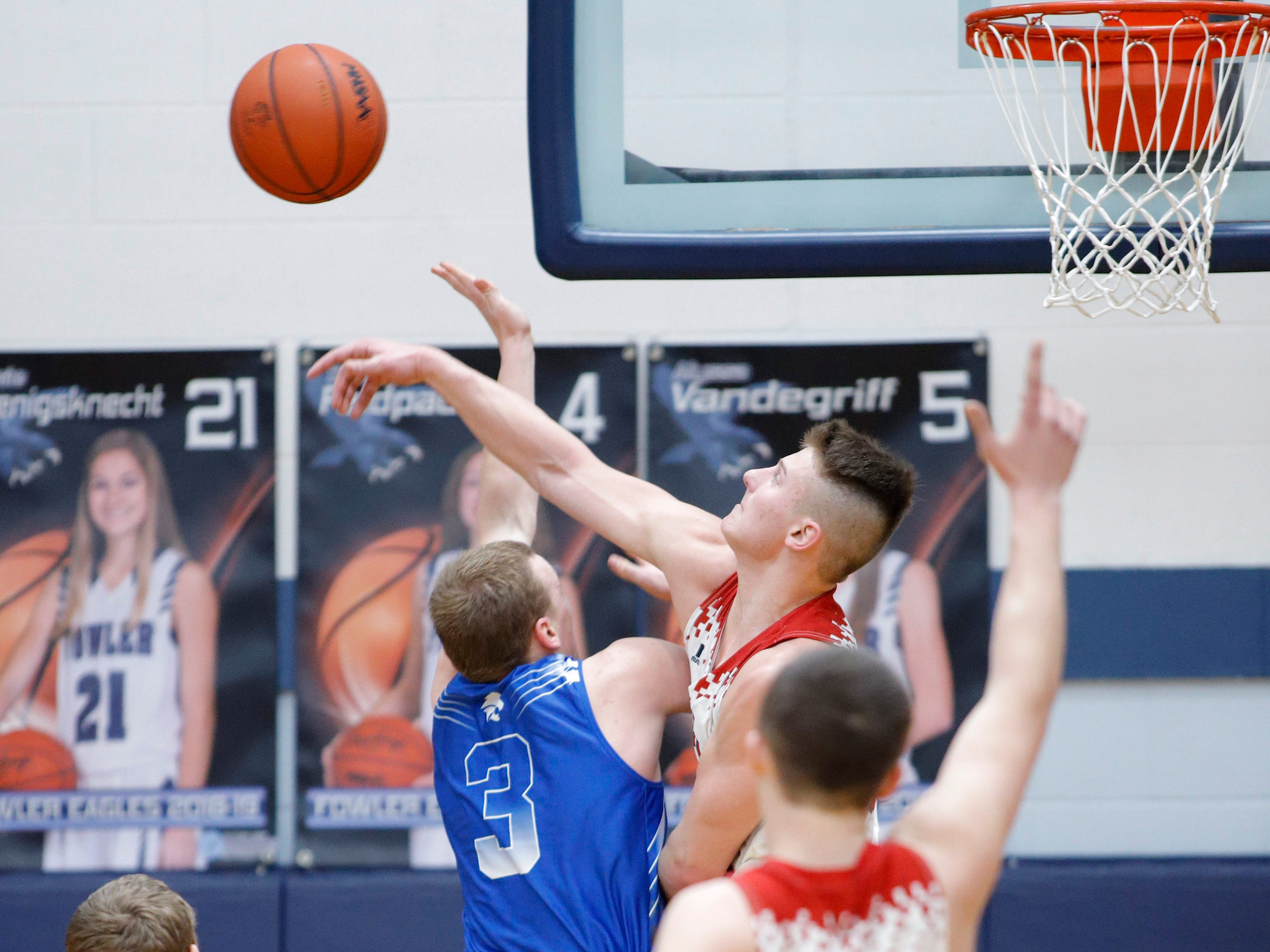 Bellevue's Caron Betz, top right, blocks a shot by Pittsford's Jesse Clement (3) in their regional final, Thursday, March 7, 2019, in Fowler, Mich. Bellevue won 42-28.