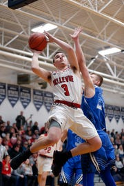 Bellevue's Gino Costello, left, puts up a driving shot against Pittsford's Jakob Burger in their regional final, Thursday, March 7, 2019, in Fowler, Mich. Bellevue won 42-28.
