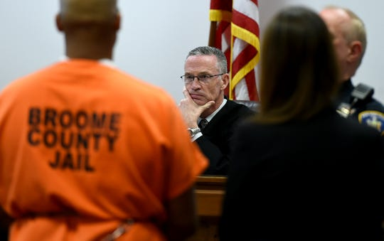 Judge Joseph Cawley listens during the sentencing of Aaron Powell for the 2013 murders of Mario Masciarelli and Christina Powell. Powell brutally killed his estranged wife and Masciarelli in the Town of Binghamton after the Christina and Masciarelli while on their first date.