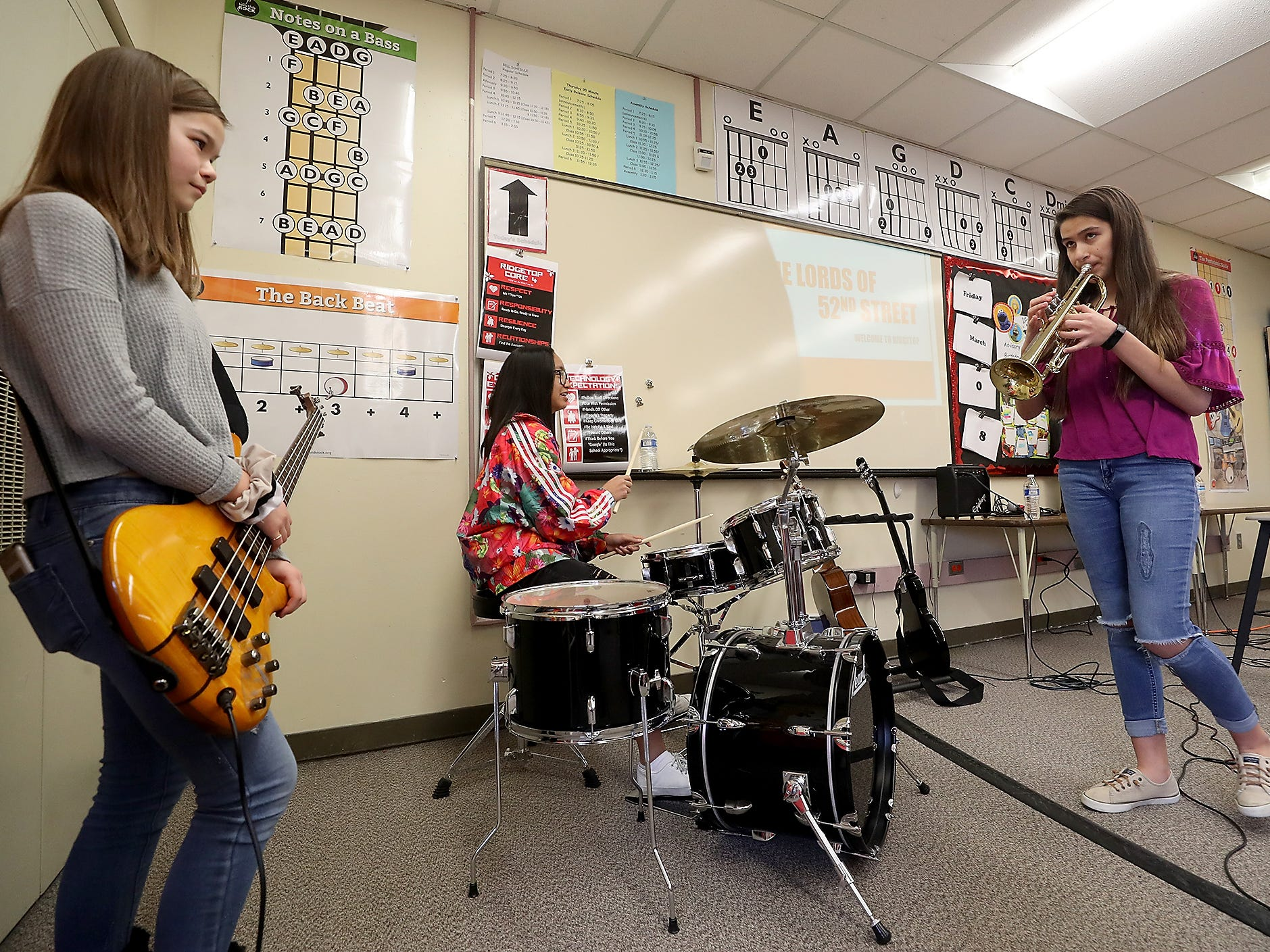 Ridgetop Middle School students (left to right) Kiyomi McKenzie, Hana Mai Elopre-Thesenga and Kiana Delacruz practice prior to arrival of The Lords of 52nd Street in Silverdale on Friday, March 8, 2019.