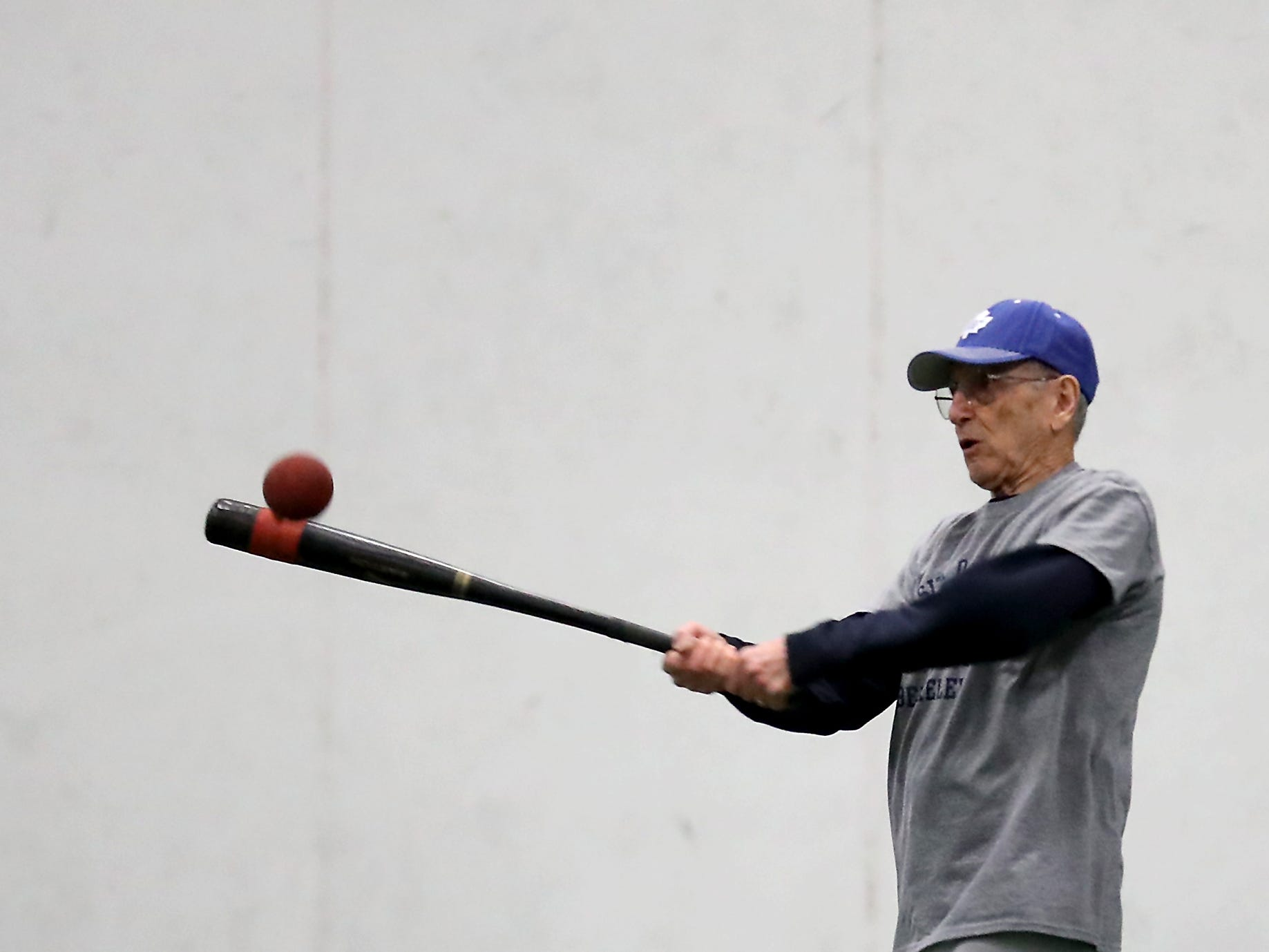 Lew Bruser, 90, bats during softball practice at Olympic Soccer Center in Bremerton on Friday, March 8, 2019.