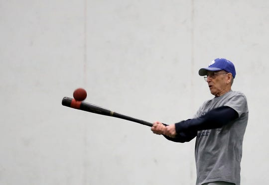 Bremerton's Lew Bruser, 90, bats during softball practice at the Olympic Sports Center on Friday, March 8. Bruser has played for the Bremerton Senior Center softball team for nearly three decades.