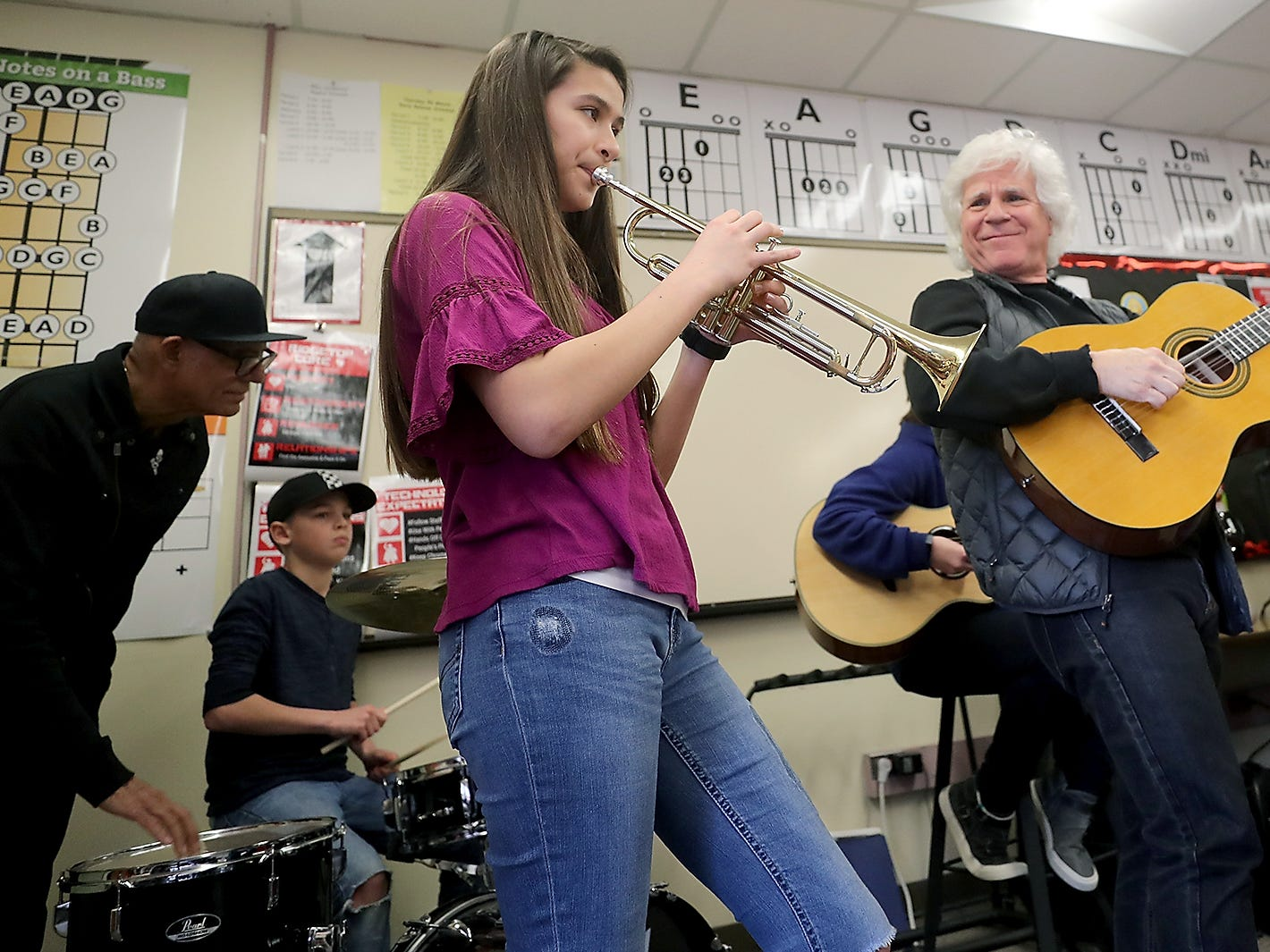 "Kiana Delacruz, 12, plays the trumpet alongside guitarist Russell Javors and the rest of The Lords of 52nd Street at Ridgetop Middle School in Silverdale on Friday, March 8, 2019. The band stopped by, prior to their show that evening at the Admiral, as part of the ""Little Kids Rock"" program which provides instruments to schools."