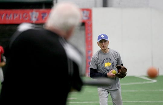 Bremerton's Lew Bruser, 90, pitches during softball practice at the Olympic Sports Center on Friday, March 8.