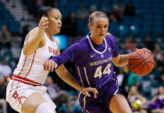 Washington's Missy Peterson drives around Utah's Sarah Porter during the first half of an NCAA college basketball game at the Pac-12 women's tournament Thursday, March 7, 2019, in Las Vegas.
