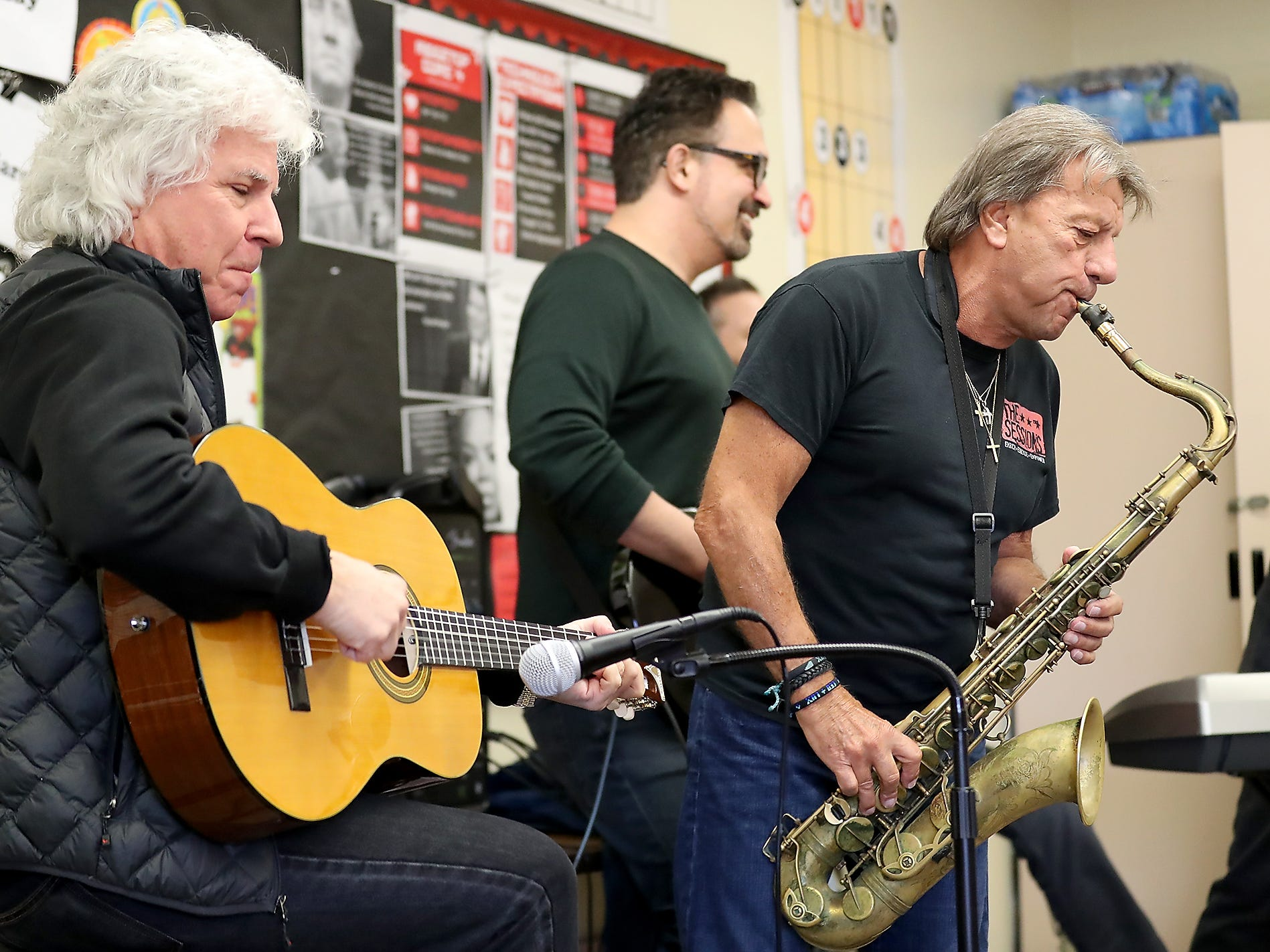 The Lords of 52nd Street's Russell Javors, left, and Richie Cannata perform with their band during a visit to Ridgetop Middle School in Silverdale on Friday, March 8, 2019.