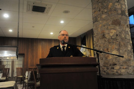 John Wilson, the deputy chief of the Black Mountain Fire Department, leads the annual banquet at Assembly Inn on March 4.