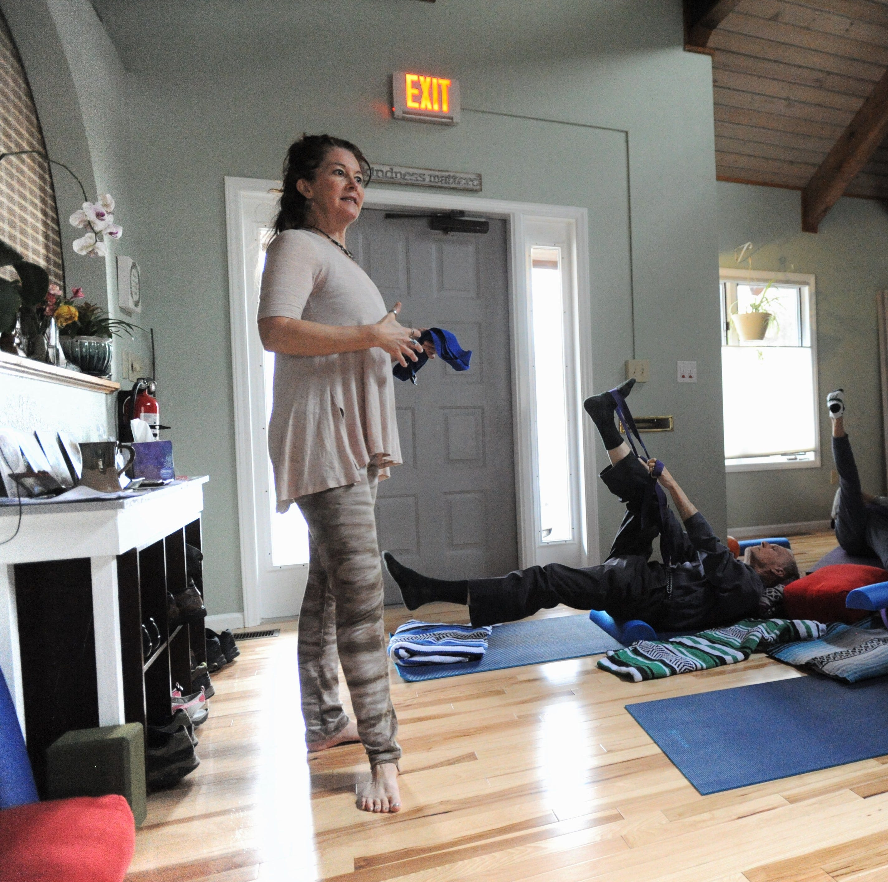 Yoga class with focus on back care still going strong in new Black Mountain location