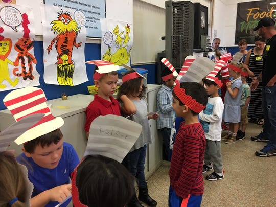 Members of teacher Barbara Wilcox's transitional kindergarten class at Tropical Elementary share snippets of facts about Dr. Seuss and his work during Dr. Seuss Day at the Merritt Island school.