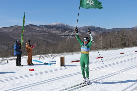 Dartmouth's Katharine Ogden, a native of Landgrove, Vermont, crosses the finish line to win the women's 15K classical race at the 2019 NCAA skiing championships on Friday at Trapp Family Lodge in Stowe.