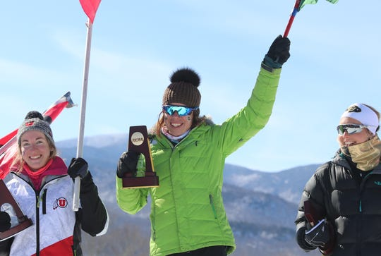Dartmouth's Katharine Ogden, a native of Landgrove, Vermont, tops the podium after winning the women's 15K classical race at the 2019 NCAA skiing championships on Friday at Trapp Family Lodge in Stowe.