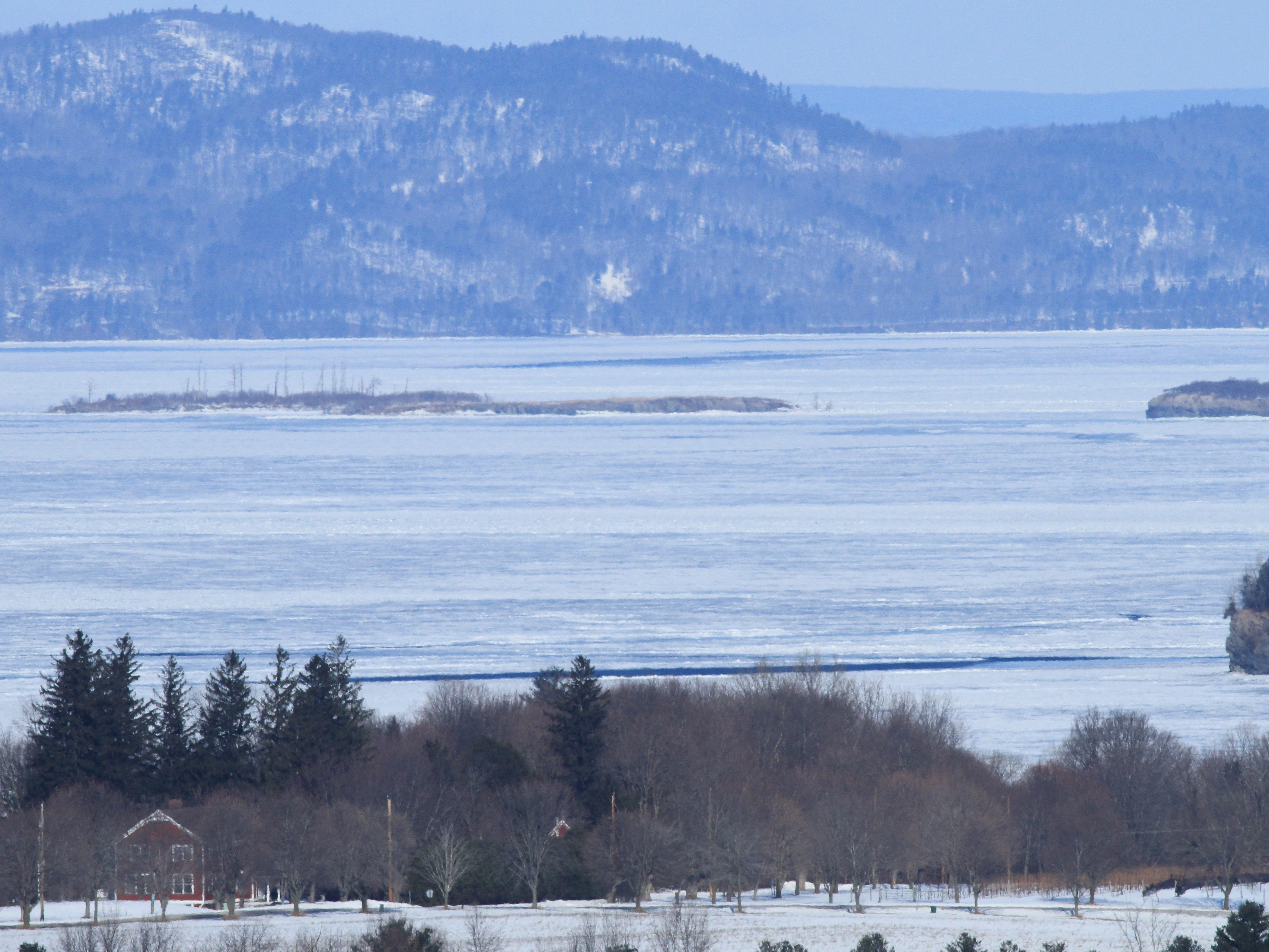 A view of Lake Champlain's multi-textured ice (and perhaps some open water), looking west from Shelburne on March 6, 2019.