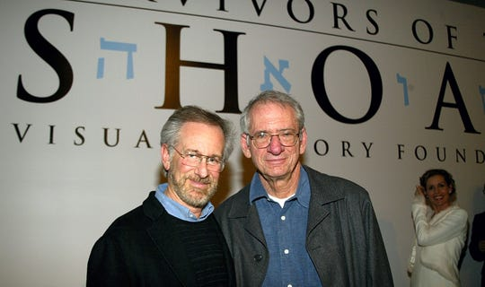 LOS ANGELES - MARCH 3:  Producer Steven Spielberg (L) and Sid Sheinberg on stage for the 'Schindler's List' DVD release at the Shoah Foundation on the Universal Studios lot March 3, 2004 in Los Angeles, CA.  (Photo by Carlo Allegri/Getty Images)