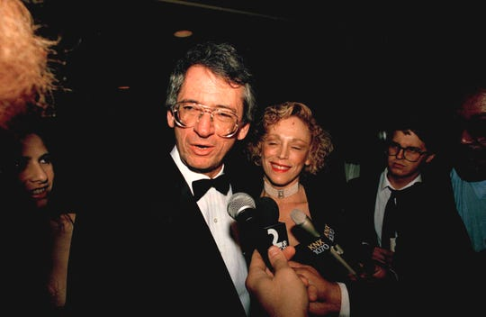 Music Corporation of America President Sidney Sheinberg and his wife actress Lorraine Gary chat with reporters in Los Angeles, April 2, 1989, as they arrive at a benefit for the American Cinematheque. Sheinberg declined to comment on the report that Sony Corp was negotiating to acquire the entertainment conglomerate. (AP Photo/Mark J. Terrill)