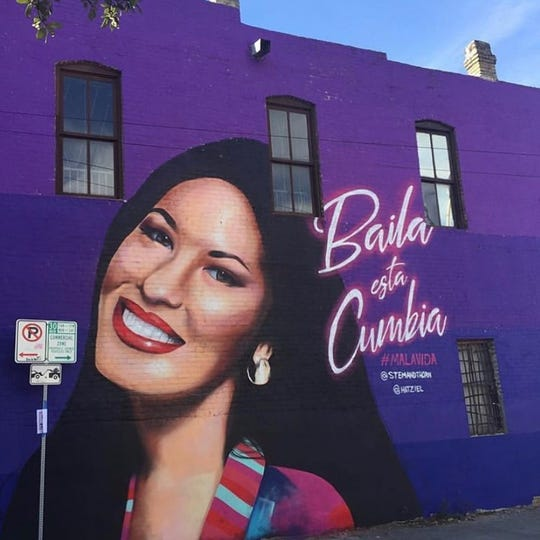 A wall was painted purple with a mural of Selena Quintanilla in Austin, Texas.
