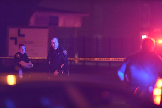 Corpus Christi police officers  investigate a double homicide on Buffalo Street near Interstate Highway 37 on Thursday, March 7, 2019.