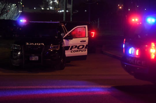 Corpus Christi police car lights flash in the Northside area, Thursday, March 7, 2019. A 41-year-old man who is accused of shooting at Corpus Christi police officers confessed to killing his girlfriend during an argument, police say.
