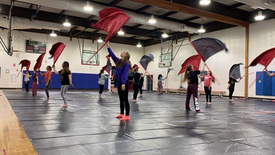 Washington Township High School's indoor color guard rehearses in the school's gym March 7, 2019. Many of the members of the indoor troupe participate in the marching band.