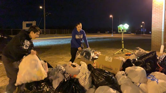 Washington Township High School Marching Band French horn player Saul Ronsayro, 15, (left) and flutist Lindsay Hager, 16, pile donated clothing for the band's clothing drive March 7, 2019.